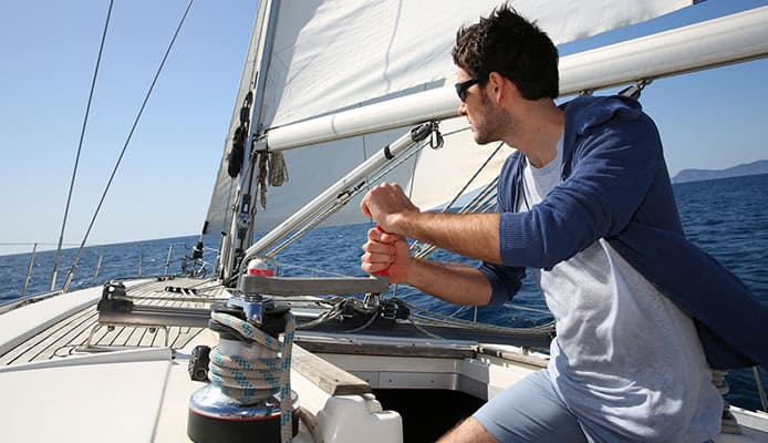 Man_sailing_in_a_boat_and_looking_in_the_distance