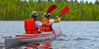 Couple_kayaking_on_a_river_in_red_vests
