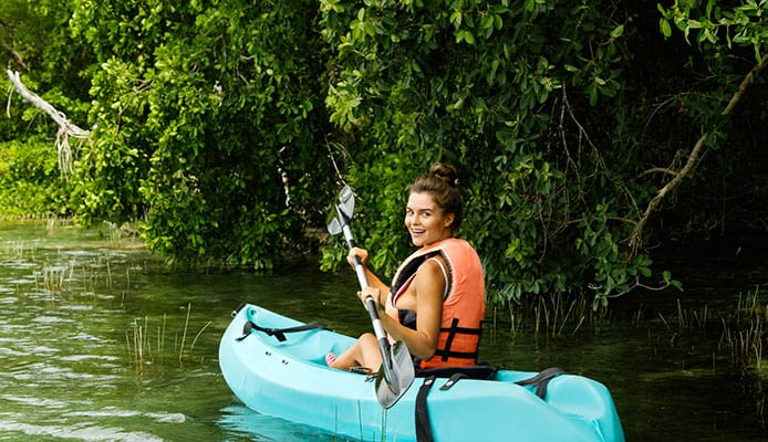 Happy_young_beautiful_woman_kayaking_in_on_the_lake